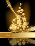 Gold Christmas tree. Made of balls Stock Photo