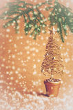 Gold Christmas tree on orange background with falling snow Royalty Free Stock Images