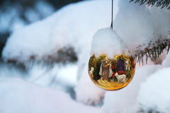 Gold Christmas Tree Ornament Reflects Nativity Sce