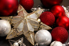 Gold Christmas Tree Star and Red Bulbs Stock Photography