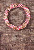 Gold Christmas wreath. With red gingham ribbon Royalty Free Stock Image