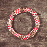 Gold Christmas wreath. With red gingham ribbon Stock Photography