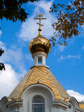 Gold Church Dome. Close view through the trees at the ornate gold roof and dome of a Christian church Royalty Free Stock Photos