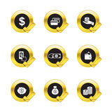 Gold circle and check mark icons  on white Royalty Free Stock Image