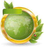 Gold circle frame with green leaf and globe Stock Photography