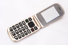 Gold clam-shell flip phone Royalty Free Stock Image