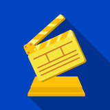 Gold clapperboard on stand.Award for best Director.Movie awards single icon in flat style vector symbol stock. Web illustration Royalty Free Stock Images