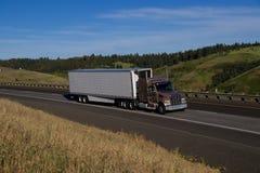 Gold Classic Semi-Truck - White Trailer Stock Photo