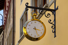 Gold clock in the streets of Stein Am Rhein Stock Photography