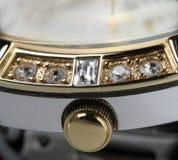 Gold clock winder macro photo. Gold clock winder extreme closeup photo Royalty Free Stock Images