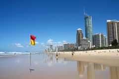 GOLD COAST, AUSTRALIA - MARCH 25, 2008: People visit the beach in Surfers Paradise, Gold Coast, Australia. With more than 500,000 royalty free stock photography