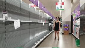 Supermarket empty toilet paper shelves amid coronavirus fears and panic buying