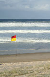 Gold Coast Beach. A vertical image of the beach at Broadbeach, Gold Coast, Australia with a lifesaving flag in the foreground Stock Image