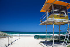Gold coast beach with lifeguard tower Royalty Free Stock Photos