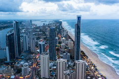Gold Coast at dusk. City by the beach at dusk, aerial, view from above. Surfers Paradise town, Gold Coast, Queensland, Australia at dusk, aerial view Royalty Free Stock Image