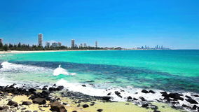 Gold Coast skyline and surf beach visible from Burleigh Heads, Queensland stock footage