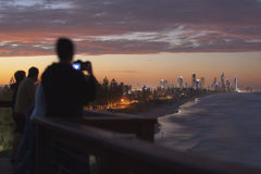 Gold Coast sunset from lookout. Tourists photographing the Gold Coast during a beautiful sunset Royalty Free Stock Image