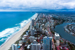Gold Coast Surfers Paradise town at dusk. City by the beach at dusk, aerial, view from above. Surfers Paradise district, Gold Coast, Queensland, Australia at Royalty Free Stock Photo