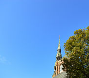 Gold weather vane in Riga, Latvia royalty free stock image