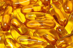 Gold cod liver fish oil Stock Image