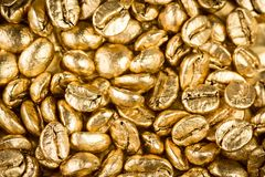 Gold coffee beans Royalty Free Stock Photo