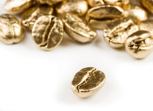 Gold coffee beans Royalty Free Stock Photos