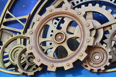 Gold Cog and wheel details from clock machines of the industrial revolution Royalty Free Stock Images