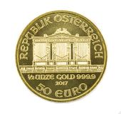 Gold coin Isolated. Gold coin Austria 1/2 ounce Vienna Philharmonic. Isolated royalty free stock photo