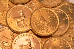 Gold coin background. Pile of gold coins (South African Krugerrands Stock Photos