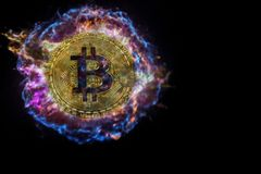 Gold coin of bitcoin explodes and flies into black space. royalty free stock images