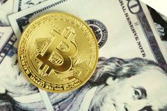 Gold coin bitcoin on hundred dollar Royalty Free Stock Photography