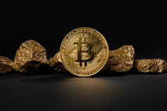 Gold coin Bitcoin and a mound of gold. Bitcoin-crypto-currency. Business concept stock images