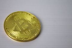 Gold coin bitcoin on white background close-up. Gold coin bitcoin on white background, close-up Stock Image