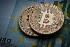 Gold coin Bitcoins, and Euro banknote Cryptocurrency Stock Image