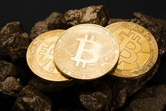 Gold coin Bitkoyn and a mound of gold. Bitcoin-crypto-currency. Business concept. Gold coin Bitkoyn and a mound of gold. Bitcoin-crypto-currency. Business stock images