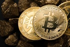 Gold coin Bitkoyn and a mound of gold. Bitcoin-crypto-currency. Business concept. Gold coin Bitkoyn and a mound of gold. Bitcoin-crypto-currency. Business royalty free stock photos