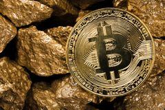 Gold coin Bitkoyn and a mound of gold. Bitcoin-crypto-currency. Business concept. Gold coin Bitkoyn and a mound of gold. Bitcoin-crypto-currency. Business stock photography