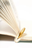Gold coin in book Stock Photography