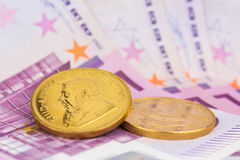 Gold coin and cash money Royalty Free Stock Photo
