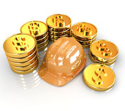 Gold coin ctack around hard hat Royalty Free Stock Image