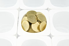 Gold coin in cup Stock Image
