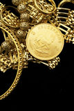 Gold coin with gold jewelry Stock Image