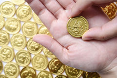 Gold coin  in hand Royalty Free Stock Photography