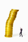 Gold coin heap collapse. Businessman afraid Gold coin heap collapse to him royalty free stock photo
