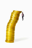 Gold coin heap almost collapse Stock Photography