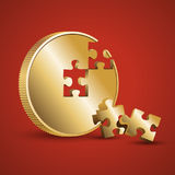 Gold coin with parts of the puzzle. The picture shows a gold coin. Two details of the puzzle fell from the coin and lie next to it. The image is on a red Royalty Free Stock Photo