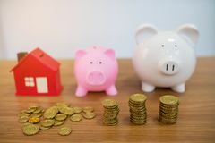 Gold coin,small house and piggybank Stock Photos