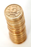Gold coin tower Stock Image