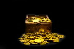 Gold Coin in treasure chest on black background stock photo