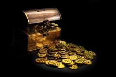 Gold Coin in treasure chest on black background royalty free stock photos